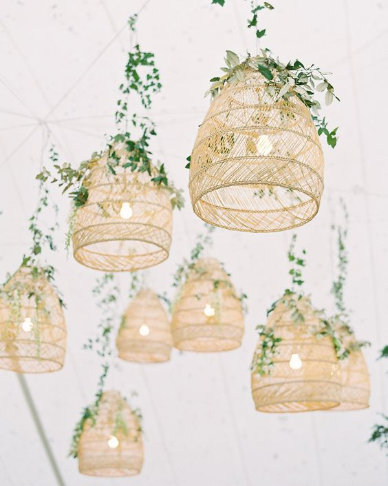 Rattan lamps hung from the top of the tent, lending a warm, laid-back vibe to the reception. Greenery helped hide the lamps' wires. #Wedding #Lights #Venue #Unique #WoodenLights #Greenery #WeddingDecor | Martha Stewart Weddings - This Maryland Wedding Melded East and West Coast Style
