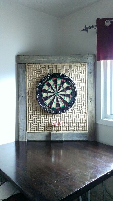 My dartboard of corks with a 9 dart holding rack diy for Diy dartboard lighting