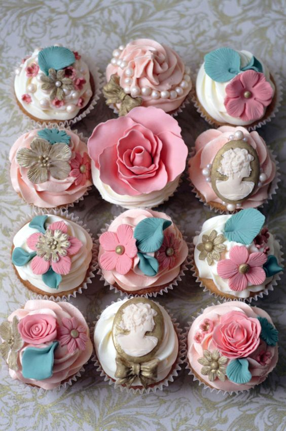 lovely cupcakes with blue and pink flowers. Wonderful victorian style with cameos, pearls, petals and bows. A Gorgeous Wedding alternative to a cake.