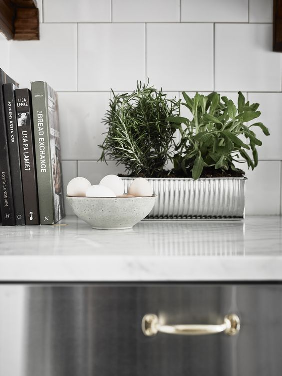 Cookbooks as styling props, kitchen details, via http://www.scandinavianlovesong.com/
