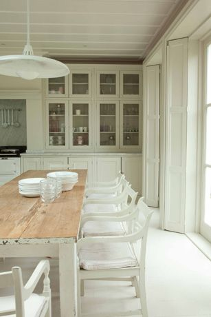 tall counter to ceiling glass cabinets in white kitchen