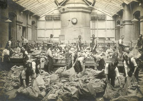 **Men sorting bags of parcels for delivery to the front, First World War. (POST 56/6)