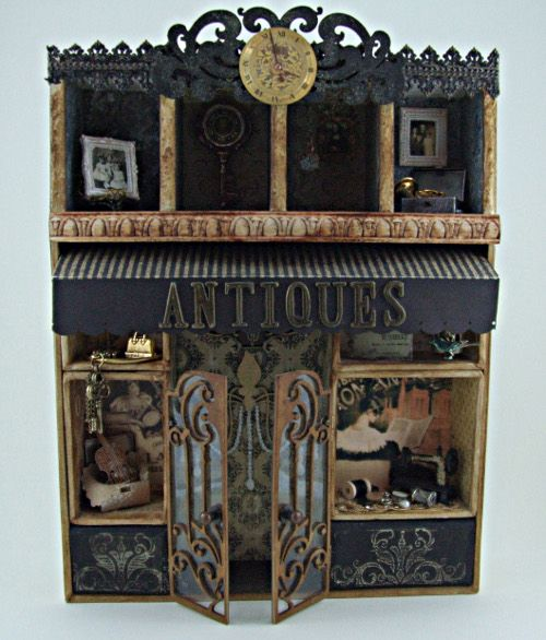 A tiny antiques shop ~ a unique idea  ~  I'd love to do one in a Paris theme with primary colors being pink, black & white....maybe a tiny mime in the window :o) (Altered Configurations Box)