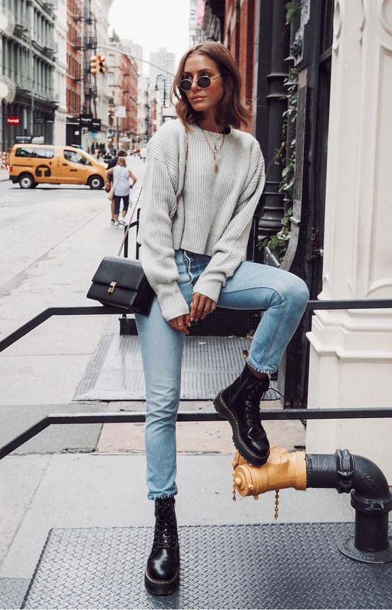 Fall and winter style; chunky sweater, frayed jeans, combat boots