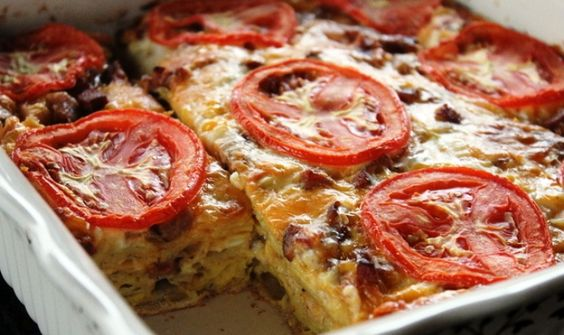Brunch Tortilla Casserole  Ingredients 6 tortillas 200-300 gr hot sausages or any type of salami – hot or not 340 gr cheese that melts easily like cheddar, mozzarella, gouda etc 8 eggs 1/2 (250 gr) cup milk or 125 gr milk and 125 gr cooking cream salt, pepper 1/2 teaspoon garlic powder 1/2 chili powder ground red pepper (for sprinkling) 1 fresh tomato for decoration