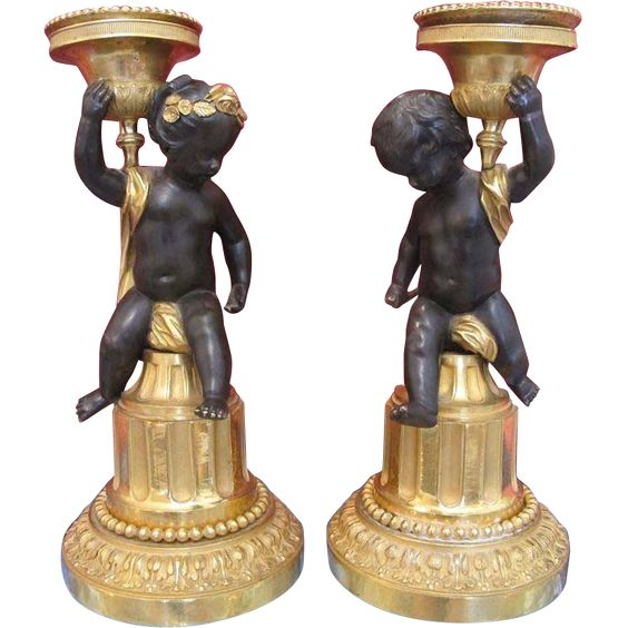 A fine pair of French Empire Gilt and patinated Bronze candle sticks,  from chateau on Ruby Lane