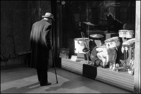 Ferdinando Scianna - Sicily, Bagheria, man watching an instrument shop window. 1962.