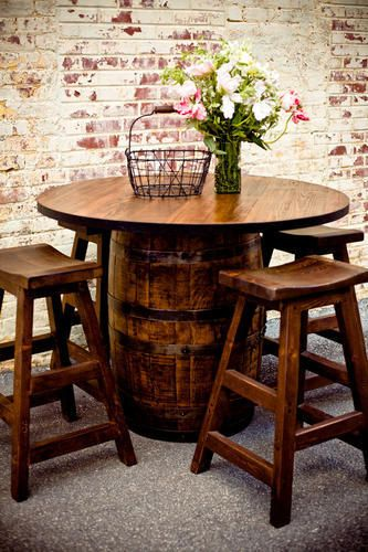 If you just want a little bit of something to make your basement feel more rustic you can get one of these wine barrel tables. With the brick background walls it really does give you rustic at a lower cost.