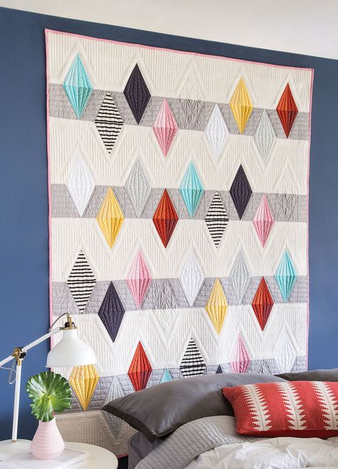 """Don't you just love how designers can be inspired by a variety of different sources, and then come up with a gorgeous quilt? We've been seeing a lot of quilts inspired by gemstones these days. From the 2017 QuiltCon best of show quilt (""""Bling"""" by Katherine Jones) to MJ Kinman's bourbon gemstone masterpieces, to the …"""