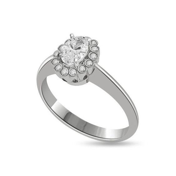 ANELLO CLUSTER CON DIAMANTE 18CT ORO BIANCO | Solitario con diamante taglio brillante montato a griffe. L`anello e` disponibile in 18ct oro bianco, 18ct oro giallo e in platino. Il peso dei carati del diamante puo` variare da 0.20ct a 0.60ct ed il colore da F ad I e la purezza da VS1 ad SI1. L`anello e` accompagnato dal certificato del diamante. Perfetto per fidanzamento, matrimonio o anniversario e come regalo nel giorno di San Valentino.