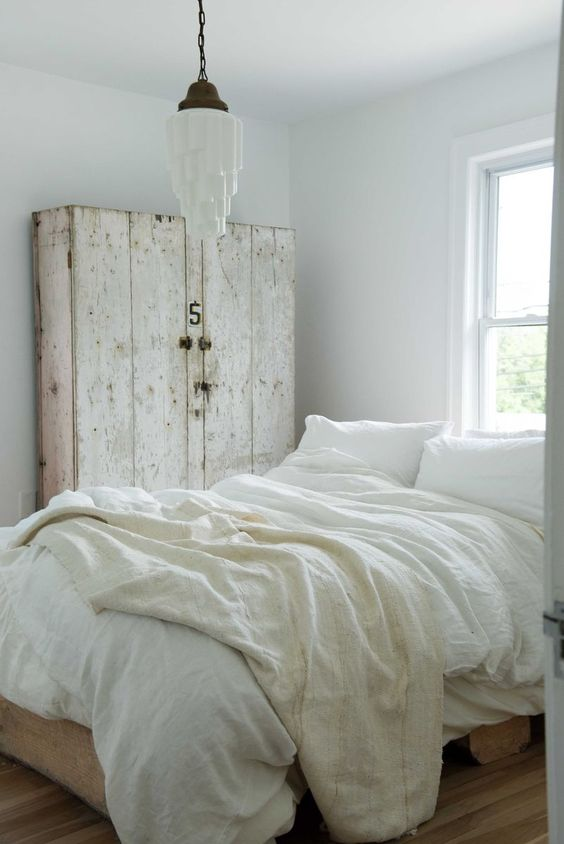 Leanne Ford white bedroom with rustic country cabinet. Romantic European Farmhouse Bedroom Decor Ideas! #rusticdecor #whitebedroom #leanneford