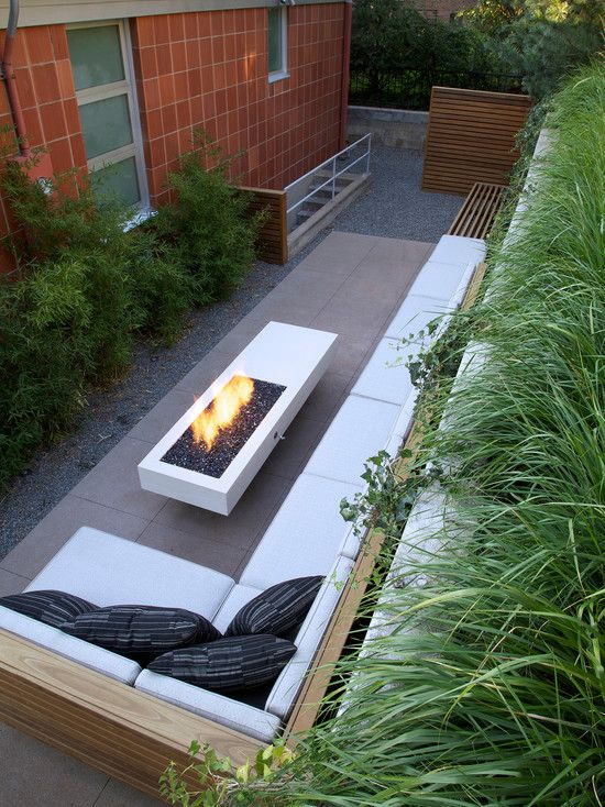 Decoration, Small Patio Design Plus L Shaped Outdoor Bench With Black  Pillows Feat Ultra Modern Fireplace Idea And Greenery Planting ~ Fantastic  Cou2026