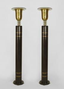 Pair of French Art Deco floor lamps with an ebonized column and inset brass rings supporting a brass uplight with a round glass shade over a stem with 3 glass rings