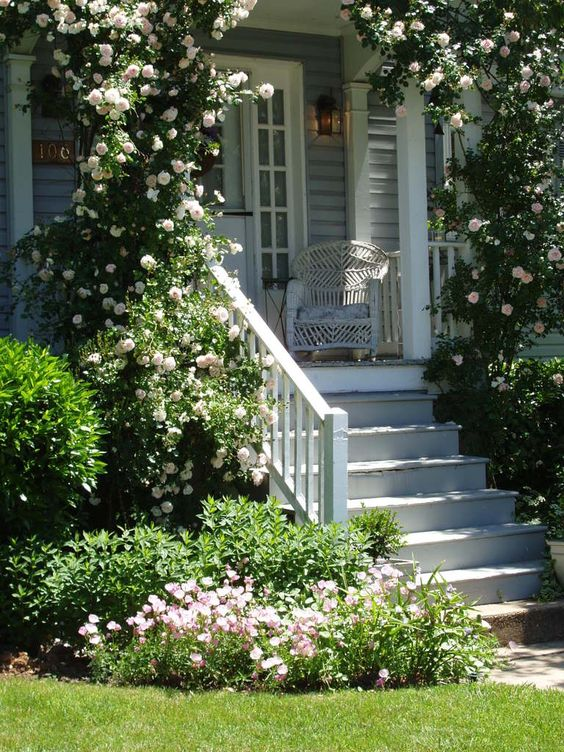This porch looks so inviting! SFH adds: Inspiration for the entrance to our home. This would be perfect.: