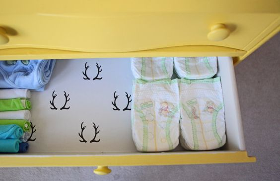 Lined dresser drawers for the changing table = yes! #nursery #storage #organization