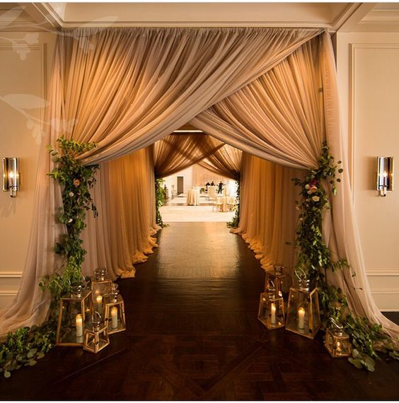 What do you think of this asymmetrical draping (for when we pull it back after ceremony)?