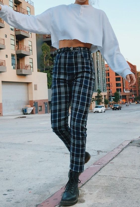 high rise checkered pants with a grey sweater crop top and combat boots. Visit Daily Dress Me at dailydressme.com for more inspiration women's fashion 2018, fall fashion, boots, high rise pants, sweaters, street style