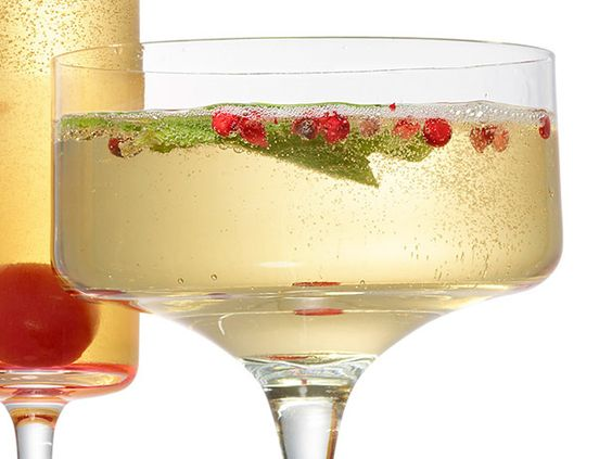 White Christmas= Put a few mint leaves in each glass. Add 2 tablespoons elderflower liqueur (such as St-Germain) and a few pink peppercorns to each. Top with sparkling wine.