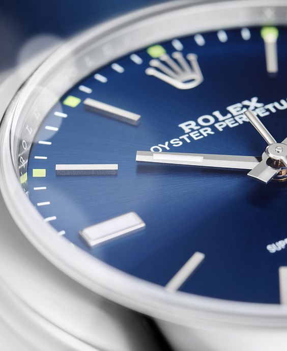 The intense blue dial of the Rolex Oyster Perpetual 39, with 18 ct white gold hour markers and green accents.