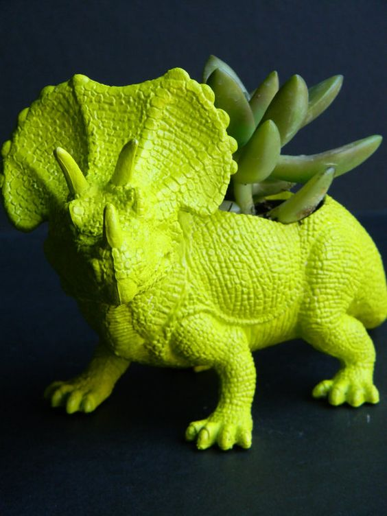 Dinosaur plant pot :) I'm loving these Dino toy planters. They are so chic. Maybe for the reception table.