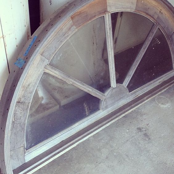 Old arched glass window insert.: