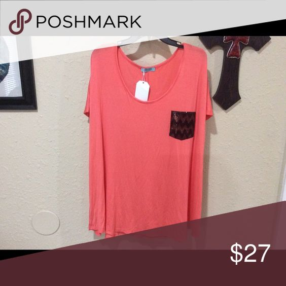 Selfee size XL pocket tee This is a new, with tags attached, boutique style Selfee size XL coral with black chevron print pocket tee. Fast shipping from a smoke free home. Offers and questions welcome. Thank you for looking. Selfee Tops Tees - Short Sleeve