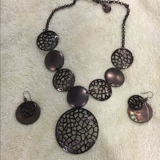 Eggplant colored necklace with matching earings Brand new, never worn necklace and earring set. Love the color but could never fund what to pair it with. Apt. 9 Jewelry Necklaces
