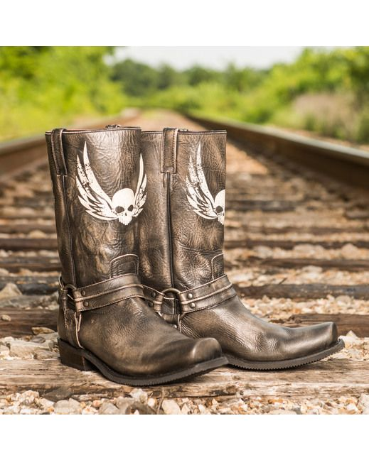 Prepare to turn heads in this powerful style by Colt Ford and Rebel Boots. The Outlaw is handcrafted from stone leather with a metallic sheen. A winged skull soars on both front and back, while a pleated harness is firmly secured to the ankle. The Outlaw rides by his own rules.
