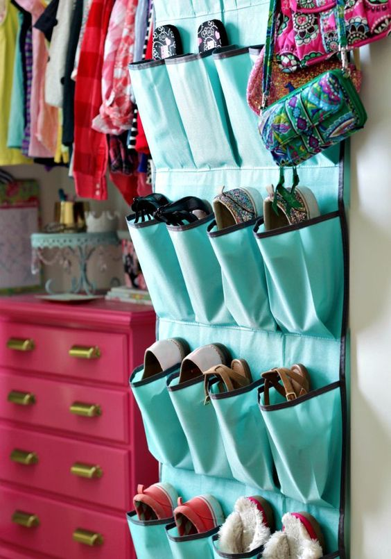 closet organizing tips for kids - use command hooks to hang shoe organizers at your child's level
