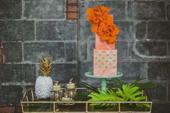 This tropical, urban paradise by planning + design: Jove Meyer Events // florals: Blade paper goods: Katie Fischer Design // rentals: Broadway Party Rental // catering: Pok Pok bar cart: Society Social // palm couch: Patina Rentals Amber Gress