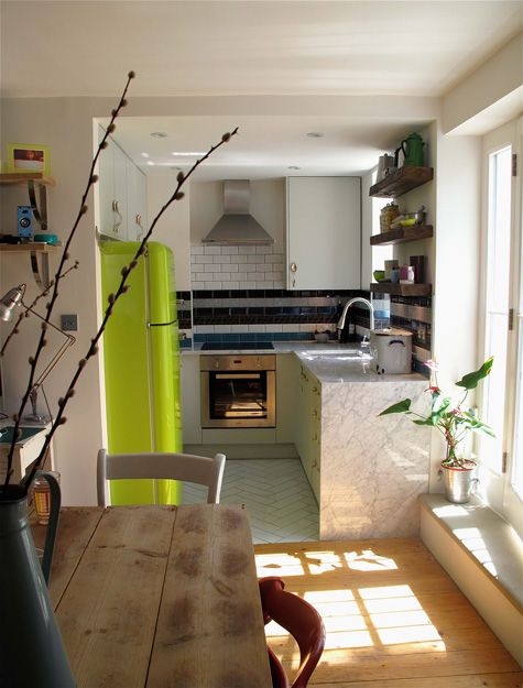 Tiny kitchen feels luxurious thanks to beautiful materials for Interior designers based in london