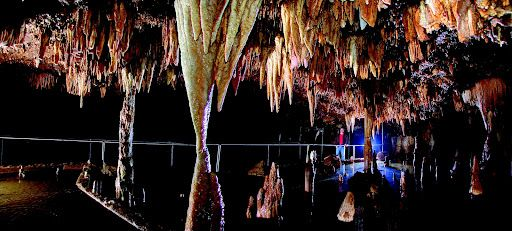 Meramec Caverns in Missouri - I've been several times and still enjoy it. It's the Tom Sawyer caves, you know, from the books. There's a room where they hold balls and stuff, inside the caverns. Too cool.