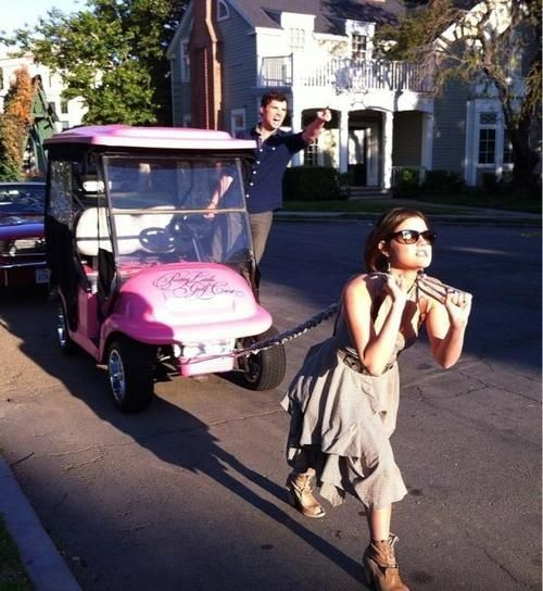 Lucy Hale (Aria) and Ian Harding (Ezra) and the pink PLL Golf Cart behind the scenes of Pretty Little Liars. #PLL