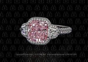 Montpassier three-stone ring featuring a radiant cut fancy vivid pink diamond by…