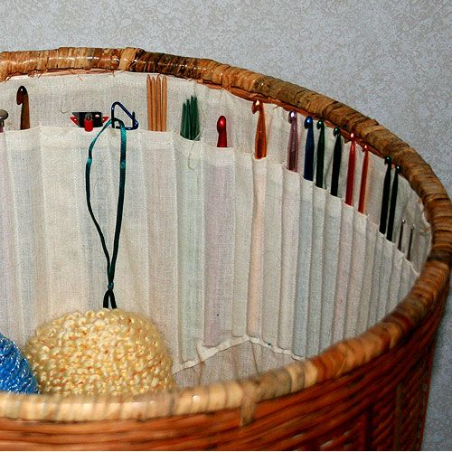 Yarn basket with crochet hook and knitting needle storage - love this for works in progress storage!