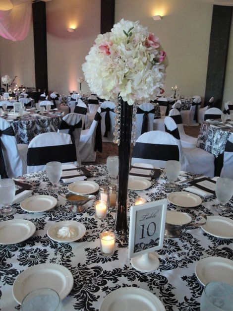 Black and white damask with eiffel tower vase centerpieces