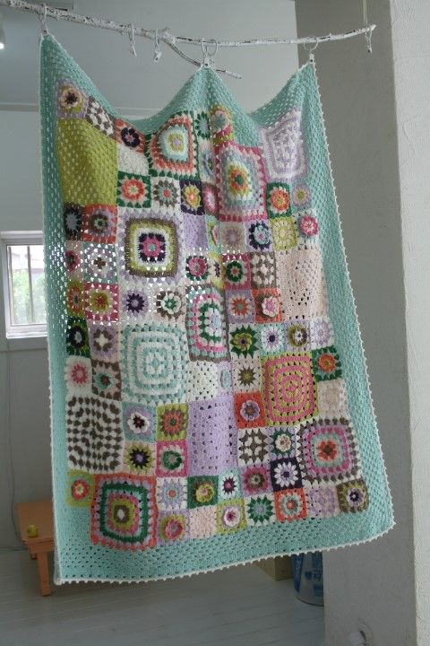 Gorgeous patchwork-style granny squares! Super pretty idea, but will definitely need to do some exploring for how to create this in reality.: