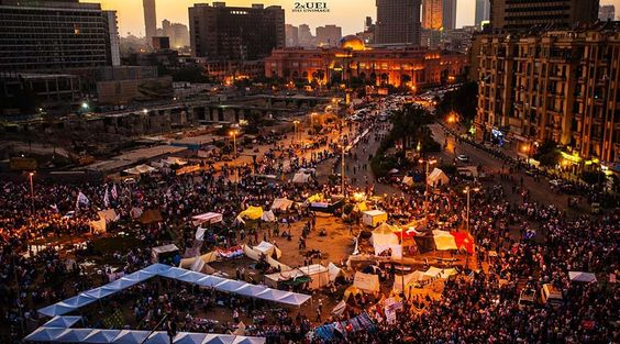 "Tahrir Square means Liberation Square. It was called ""Ismailia Square"". It located downtown of Cairo in Egypt. Khedive Ismail commissioned the new downtown"