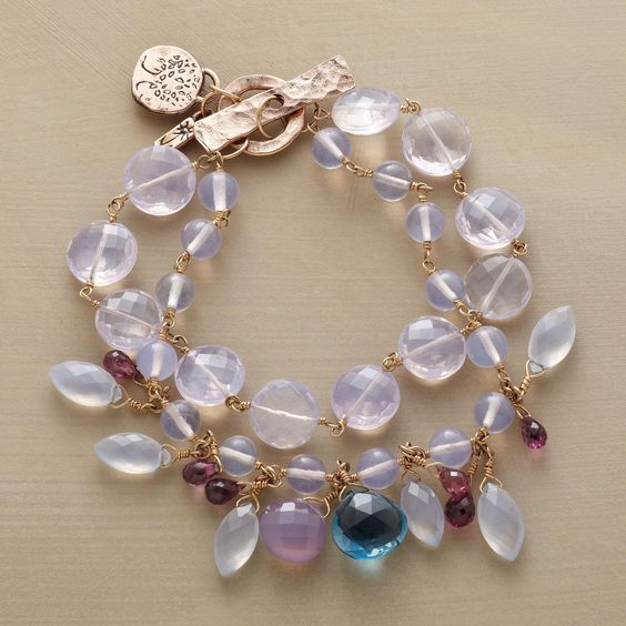 LAVENDER QUARTZ BRACELET--Jes MaHarry offers a glimpse of her garden, sprinkling two strands of lilac quartz with amethyst briolettes, chalcedony and a showstopper London blue topaz. Exclusive. Handmade in USA with 14kt rose gold toggle