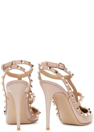 Valentino blush patent leather pumps  Heel measures approximately 4 inches/ 100mm  Pale gold stud embellishments, blush T-bar and trims, pointed toe  Buckle-fastening ankle straps