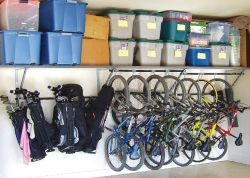 Idea for storing golf clubs & bikes in garage - low enough to reach, more storage above?
