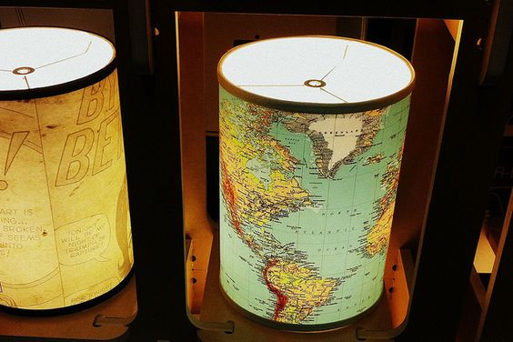 Map lamp shades.  Could use maps from travel books -- or all those vacation planning packages I've gotten...