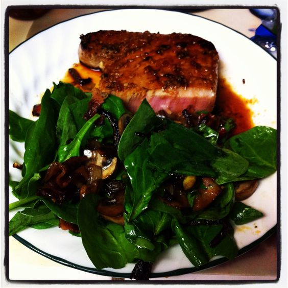 Had and made this a few weeks ago....Grilled Tuna Steak and a Spinach Salad w/sautéed mushroom, onion, and bacon and a lite vinaigrette homemade dressing....sooooo damn good!!!!!