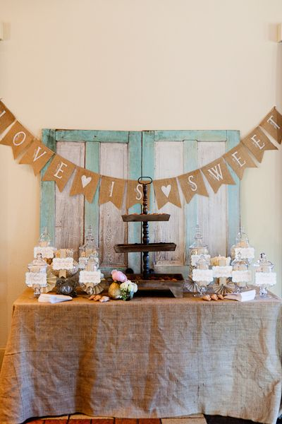 burlap banner...with lace outline behind burlap? Love is sweet, etc- triangle shaped.  Hot glue to twine.: