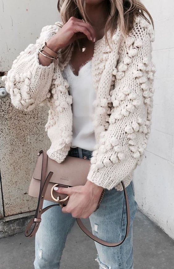 Winter white knit cardigan over white tee and blue jeans.