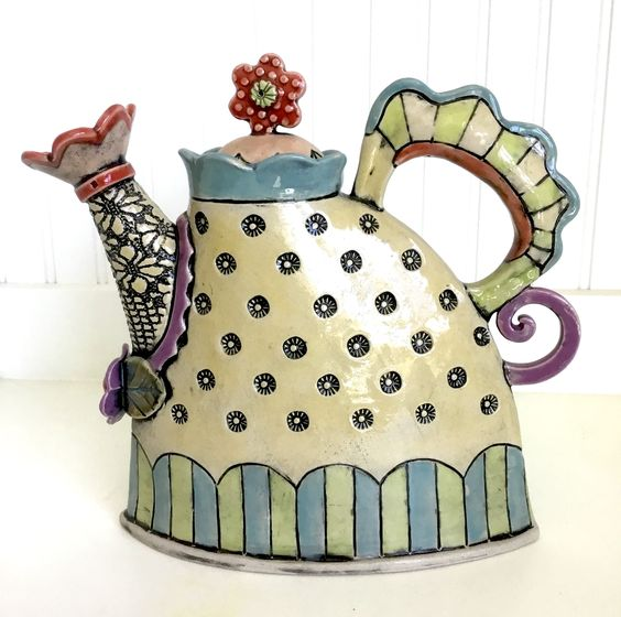Handmade slab pottery Teapot with scallops, stripes and lid with daisy handle. Glazes include Celebration Turquoise, Pear, Celebration Lilac, Coyote Peach Blush, Sedona Sunset, Sunshine Yellow.