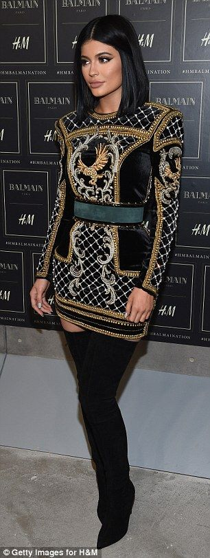 Model pose: Kylie showed off more of those thigh-high boots and heavily detailed dress at ...