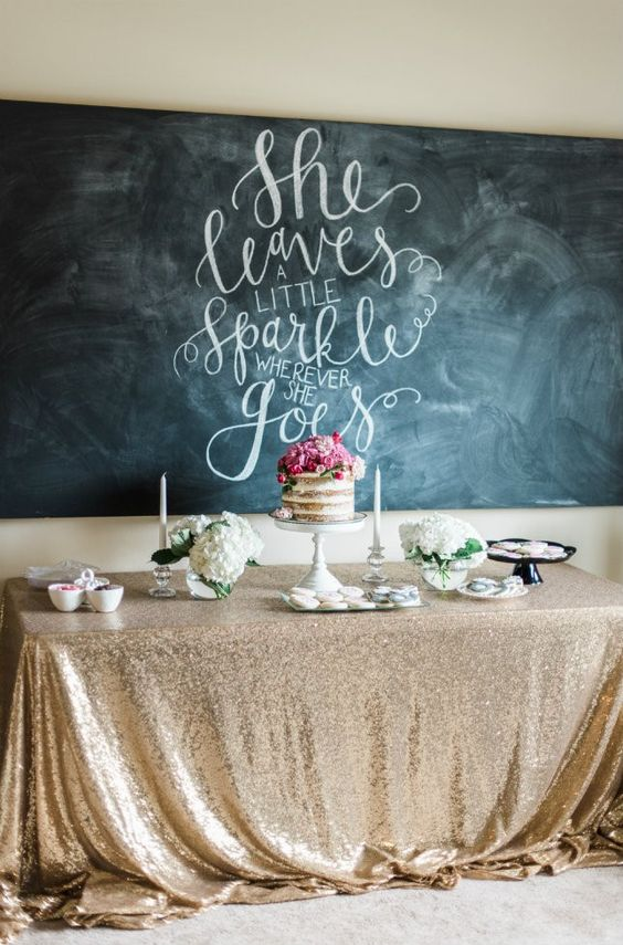 Swooning over this gold-sequined tablecloth + scripted quote in the background of this dessert table.: