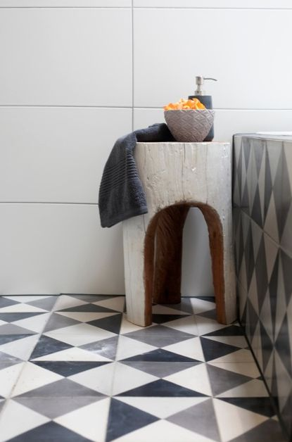 Tiles running up the side of the bath; a great idea if you want a bathroom revamp without a big budget.