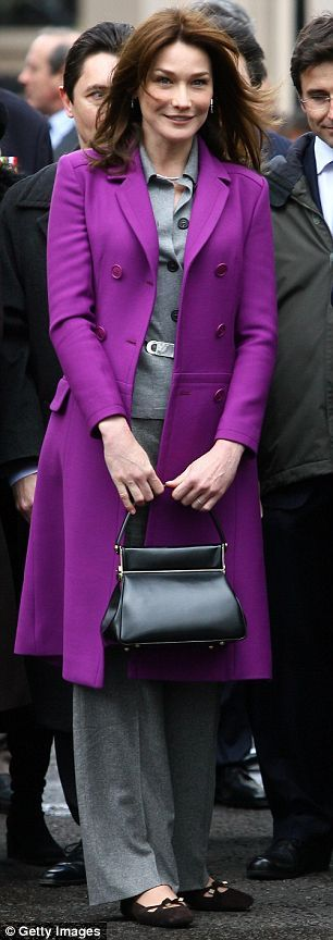 Not really royalty, but... Carla Bruni in Dior purple coat -- She's mastered the royal solution for standing out in a crowd: